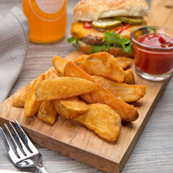 Lamb Weston Holdings Lamb's Seasoned Wedge Cut Fries 5 lb. Bag - 6/Case Main Image 4