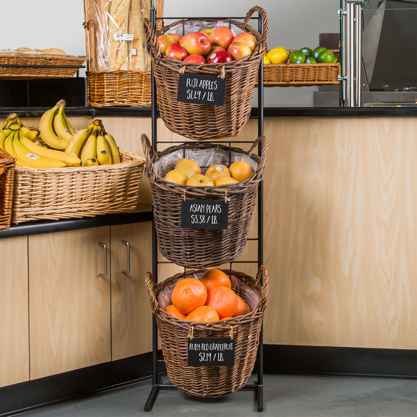 three baskets hanging on a rack with fresh fruit