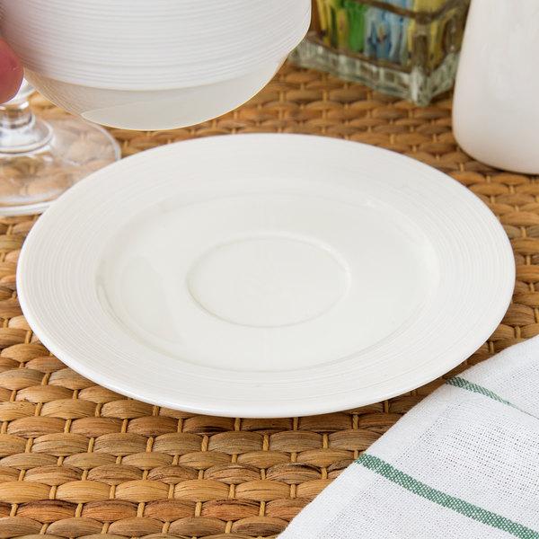 "Oneida L5650000500 Manhattan 6 1/4"" Warm White Porcelain Coupe Saucer - 48/Case"