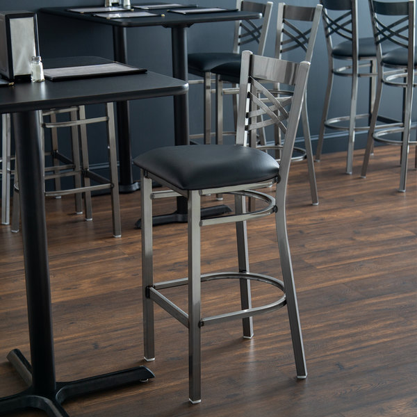"Lancaster Table & Seating Clear Coat Steel Cross Back Bar Height Chair with 2 1/2"" Black Padded Seat"
