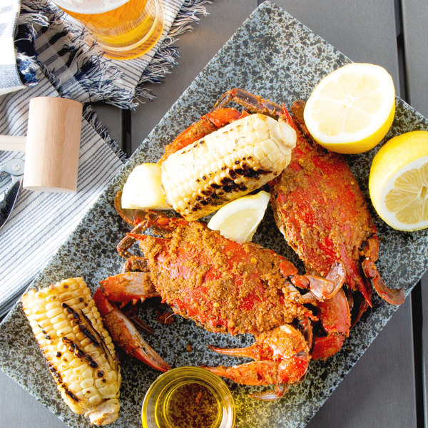 "Linton's Seafood 5 1/4"" Heavily Seasoned Steamed Medium Maryland Blue Crabs - 42/Case"