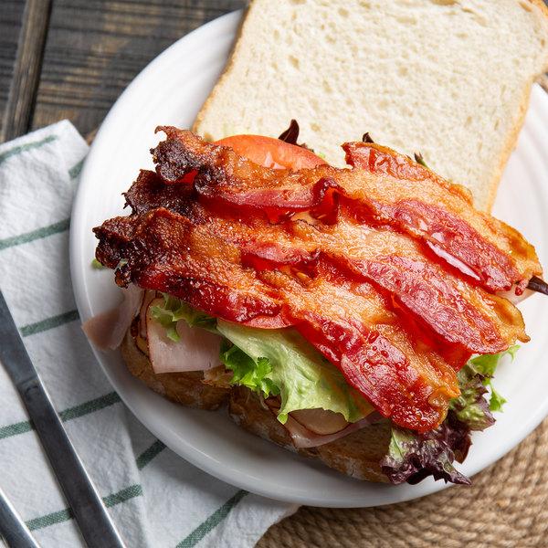 Kunzler 1 lb. Honey Cured Lower Sodium Hardwood Smoked Sliced Bacon - 12/Case Main Image 2