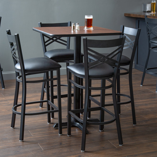 "With (4) Padded Seat Black Cross Back Barstools Lancaster Table & Seating 30"" x 30"" Reversible Walnut / Oak Bar Height Dining Set"