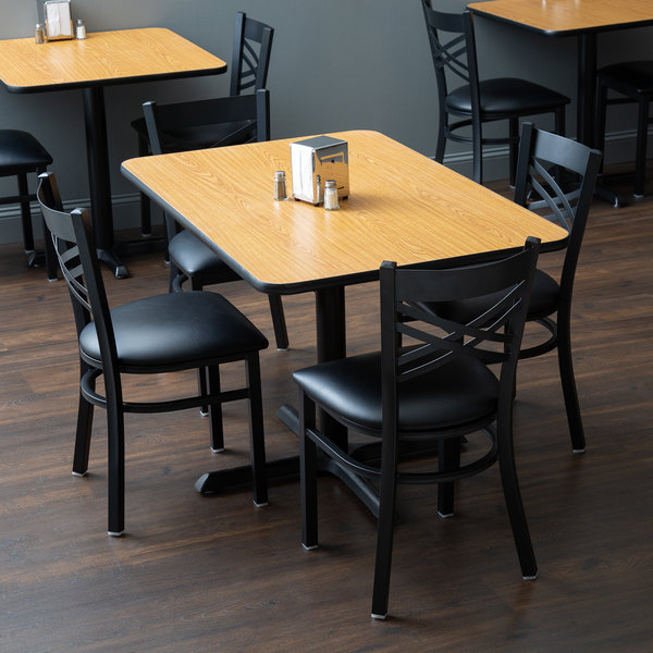 "With (4) Padded Seat Black Cross Back Chairs Lancaster Table & Seating 30"" x 48"" Reversible Walnut / Oak Standard Height Dining Set"