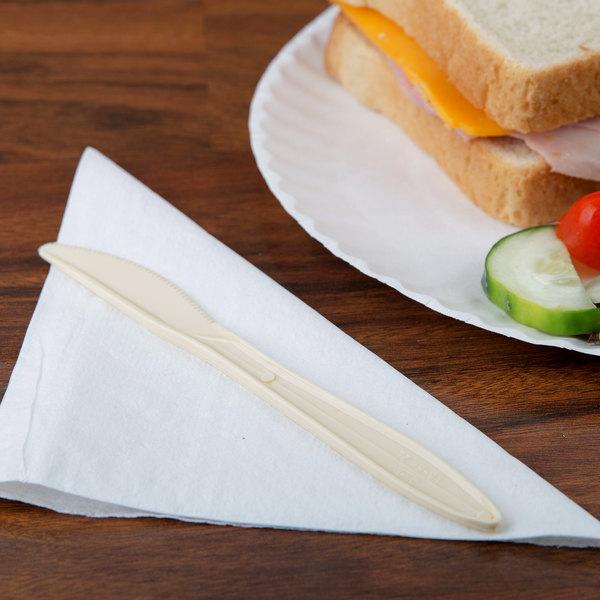 "Dart K6BH 6 1/2"" Medium Weight Honey Plastic Knife - 100/Pack"