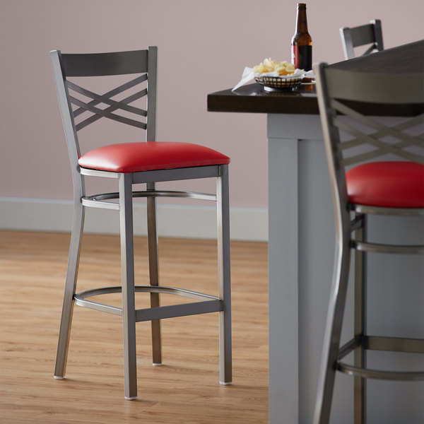 """Preassembled Lancaster Table & Seating Clear Coat Steel Cross Back Bar Height Chair with 2 1/2"""" Red Vinyl Seat"""