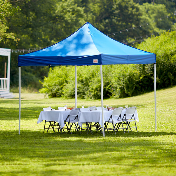 Blue Galaxy Equipment canopy set up outdoors over 2 tables set for an event
