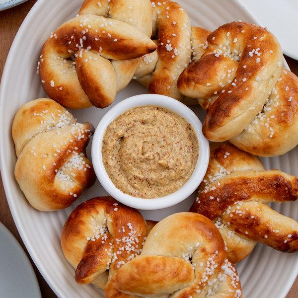 Bavarian pretzels on plate with horseradish mustard