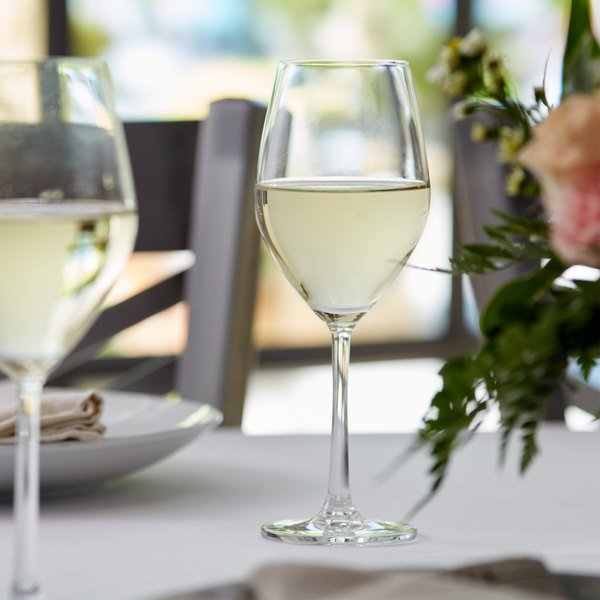 White wine glass filled with chardonnay wine on an elegant table