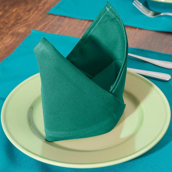 "20"" x 20"" Green Hemmed Polyspun Cloth Napkin - 12/Pack"
