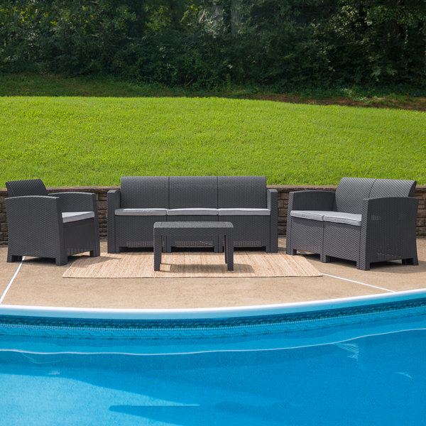 Gray Flash Furniture lounge set with couch and 2 chairs with a pool in front