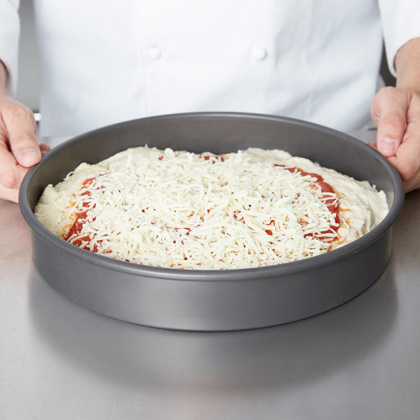 Pizza in a hard anodized aluminum baking pan