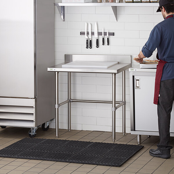 "Regency 24"" x 36"" 14-Gauge 304 Stainless Steel Commercial Open Base Work Table with 4"" Backsplash Main Image 4"
