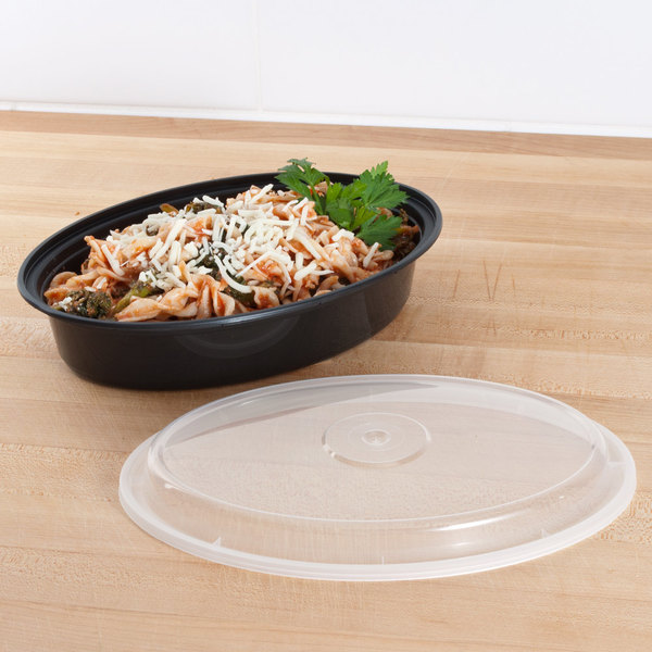 "Pactiv Newspring OC32B 32 oz. Black 9 1/8"" x 6 3/4"" x 2"" VERSAtainer Oval Microwavable Container With Lid - 150/Case"
