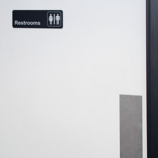 "Black and White Unisex Restrooms Sign 9"" x 3"""