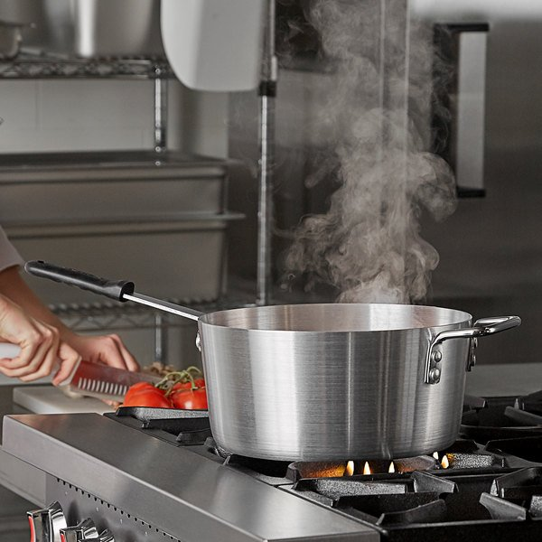 Carlisle tapered sauce pan simmering on a stove