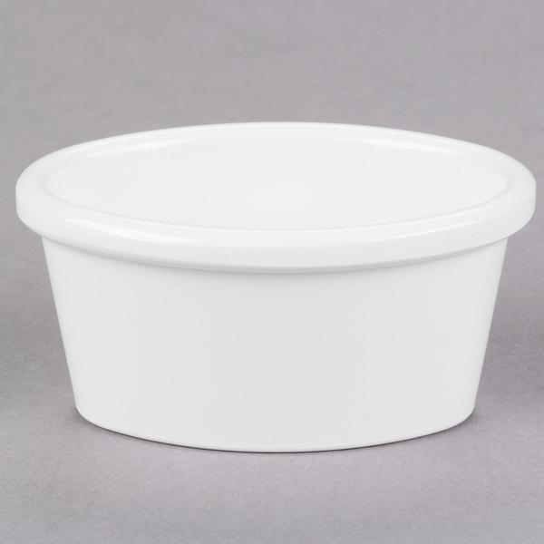 Carlisle S31002 2 oz. Smooth White Oval Melamine Ramekin - 48/Case