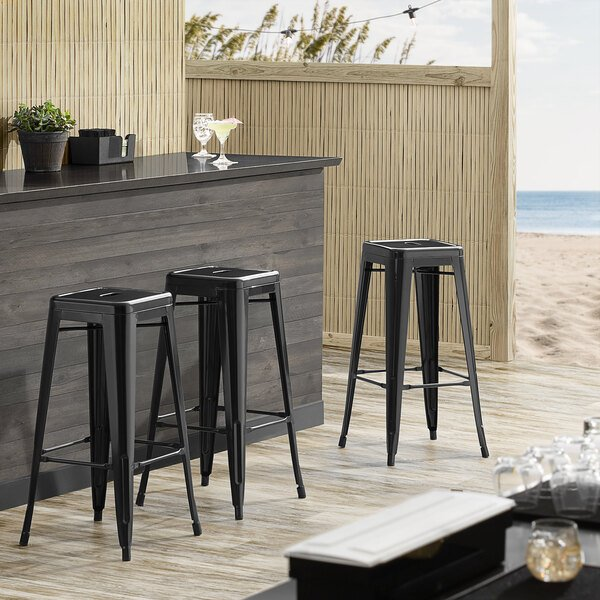 Lancaster Table & Seating Alloy Series Black Stackable Metal Indoor / Outdoor Industrial Barstool with Drain Hole Seat Main Image 3