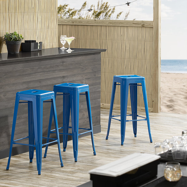 Lancaster Table & Seating Alloy Series Blue Stackable Metal Indoor / Outdoor Industrial Barstool with Drain Hole Seat Main Image 3