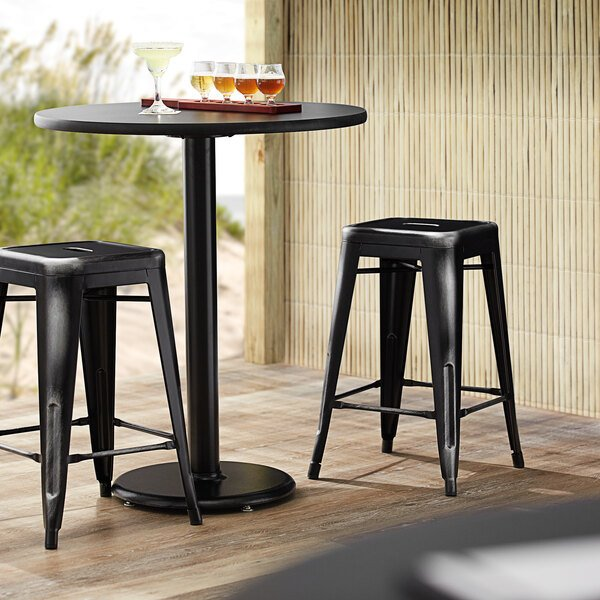 Lancaster Table & Seating Alloy Series Distressed Black Stackable Metal Indoor / Outdoor Industrial Cafe Counter Height Stool with Drain Hole Seat Main Image 3