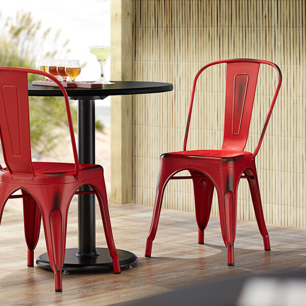 Lancaster Table & Seating Alloy Series Distressed Red Metal Indoor / Outdoor Industrial Cafe Chair with Vertical Slat Back and Drain Hole Seat Main Image 4