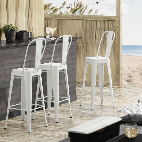 Lancaster Table & Seating Alloy Series White Metal Indoor / Outdoor Industrial Cafe Barstool with Vertical Slat Back and Drain Hole Seat Main Image 4