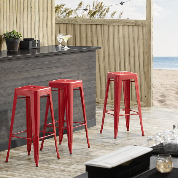Lancaster Table & Seating Alloy Series Red Stackable Metal Indoor / Outdoor Industrial Barstool with Drain Hole Seat Main Image 3