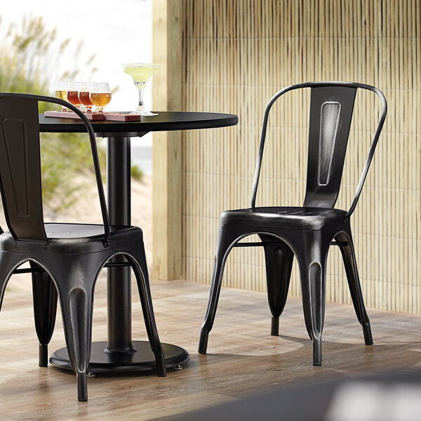 Lancaster Table & Seating Alloy Series Distressed Black Metal Indoor / Outdoor Industrial Cafe Chair with Vertical Slat Back and Drain Hole Seat Main Image 4