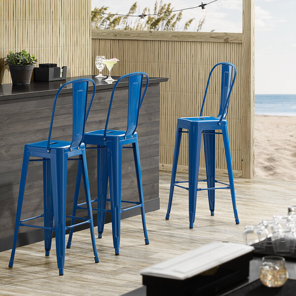 Lancaster Table & Seating Alloy Series Blue Metal Indoor / Outdoor Industrial Cafe Barstool with Vertical Slat Back and Drain Hole Seat Main Image 4