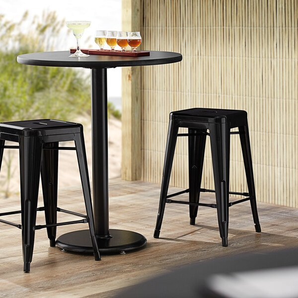 Lancaster Table & Seating Alloy Series Black Stackable Metal Indoor / Outdoor Industrial Cafe Counter Height Stool with Drain Hole Seat Main Image 3
