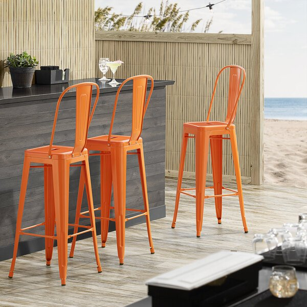 Lancaster Table & Seating Alloy Series Orange Metal Indoor / Outdoor Industrial Cafe Barstool with Vertical Slat Back and Drain Hole Seat Main Image 4