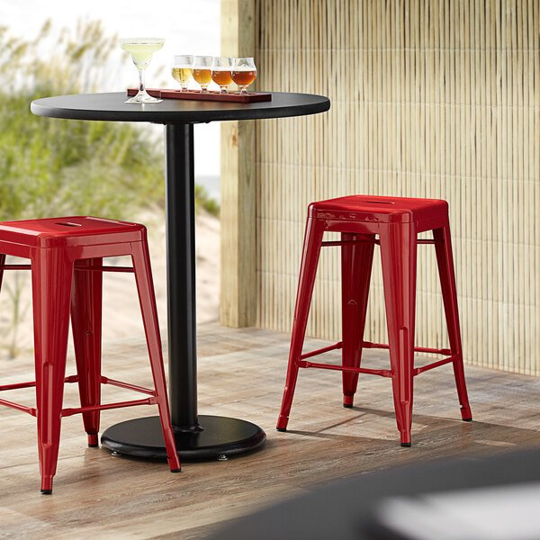 Lancaster Table & Seating Alloy Series Red Stackable Metal Indoor / Outdoor Industrial Cafe Counter Height Stool with Drain Hole Seat Main Image 3