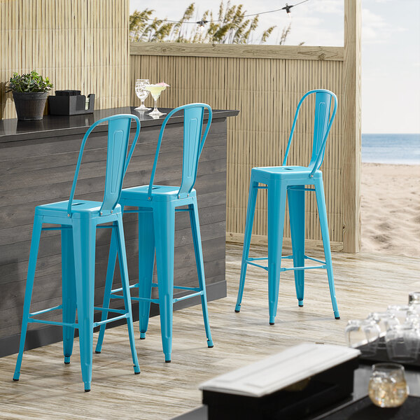 Lancaster Table & Seating Alloy Series Arctic Blue Metal Indoor / Outdoor Industrial Cafe Barstool with Vertical Slat Back and Drain Hole Seat Main Image 4