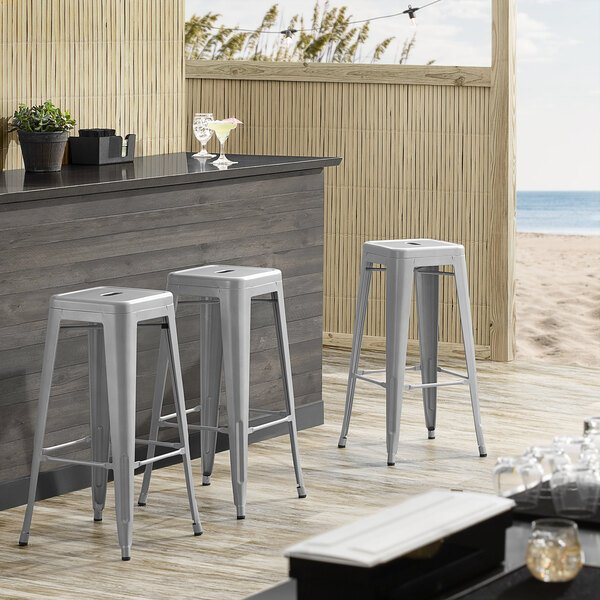 Lancaster Table & Seating Alloy Series Silver Stackable Metal Indoor / Outdoor Industrial Barstool with Drain Hole Seat Main Image 3