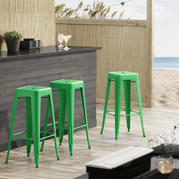 Lancaster Table & Seating Alloy Series Green Stackable Metal Indoor / Outdoor Industrial Barstool with Drain Hole Seat Main Image 3