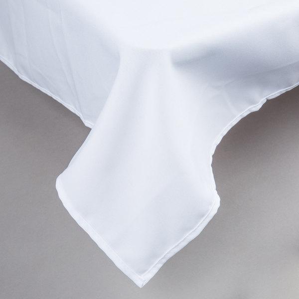 "64"" x 120"" Rectangular White 100% Polyester Hemmed Cloth Table Cover"