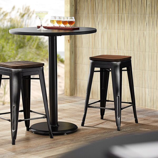 Lancaster Table & Seating Alloy Series Distressed Black Metal Indoor Industrial Cafe Counter Height Stool with Walnut Wood Seat Main Image 3