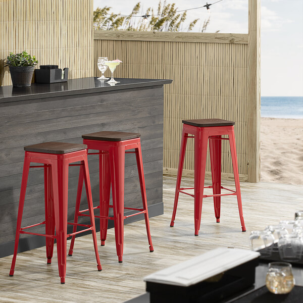 Lancaster Table & Seating Alloy Series Red Metal Indoor Industrial Cafe Bar Height Stool with Walnut Wood Seat Main Image 3