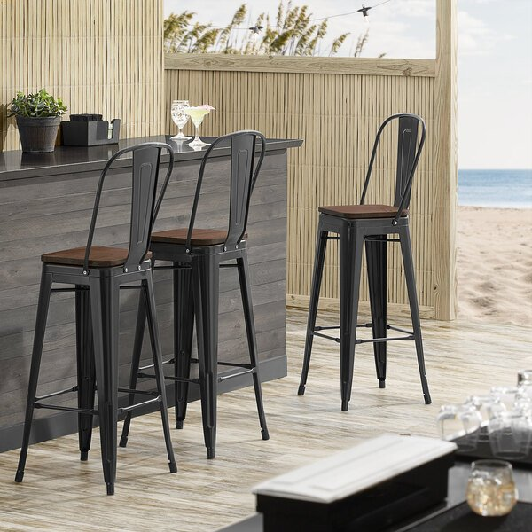 Lancaster Table & Seating Alloy Series Black Metal Indoor Industrial Cafe Bar Height Stool with Vertical Slat Back and Walnut Wood Seat Main Image 4