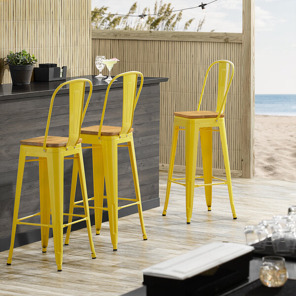 Lancaster Table & Seating Alloy Series Yellow Metal Indoor Industrial Cafe Bar Height Stool with Vertical Slat Back and Natural Wood Seat Main Image 4