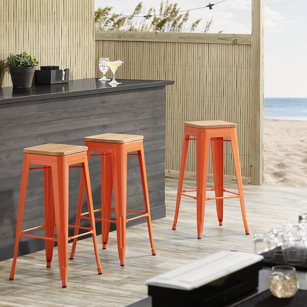 Lancaster Table & Seating Alloy Series Orange Metal Indoor Industrial Cafe Bar Height Stool with Natural Wood Seat Main Image 3