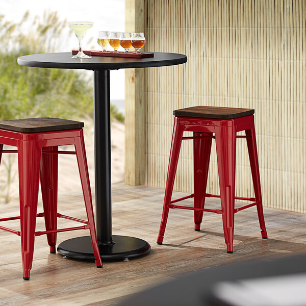 Lancaster Table & Seating Alloy Series Red Metal Indoor Industrial Cafe Counter Height Stool with Walnut Wood Seat Main Image 3