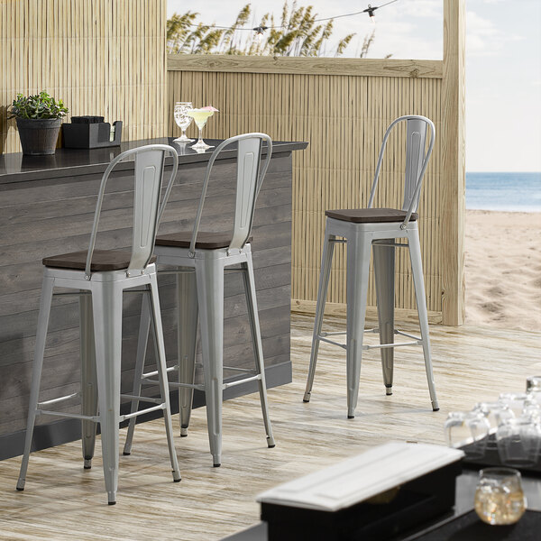 Lancaster Table & Seating Alloy Series Silver Metal Indoor Industrial Cafe Bar Height Stool with Vertical Slat Back and Black Wood Seat Main Image 4