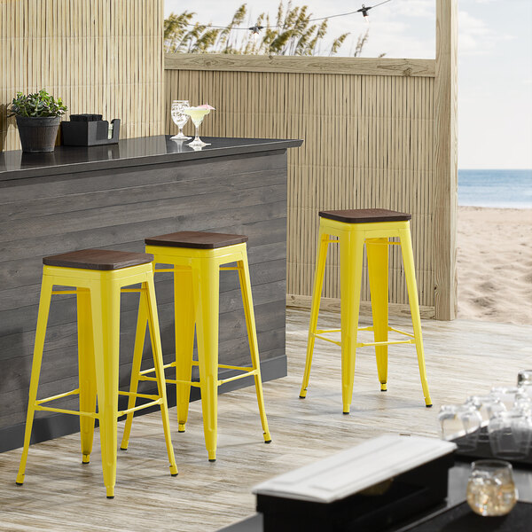 Lancaster Table & Seating Alloy Series Yellow Metal Indoor Industrial Cafe Bar Height Stool with Walnut Wood Seat Main Image 3