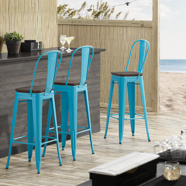 Lancaster Table & Seating Alloy Series Arctic Blue Metal Indoor Industrial Cafe Bar Height Stool with Vertical Slat Back and Black Wood Seat Main Image 4