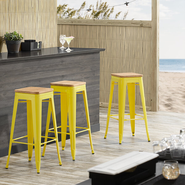 Lancaster Table & Seating Alloy Series Yellow Metal Indoor Industrial Cafe Bar Height Stool with Natural Wood Seat Main Image 3