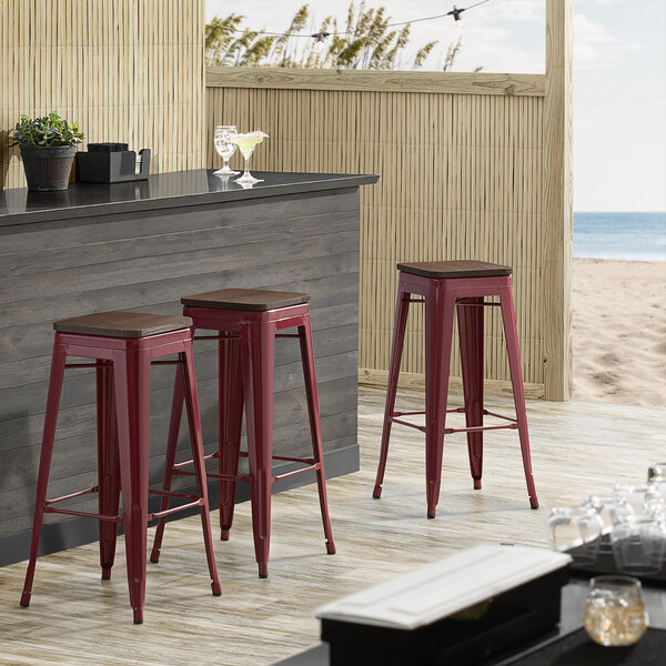 Lancaster Table & Seating Alloy Series Sangria Metal Indoor Industrial Cafe Bar Height Stool with Walnut Wood Seat Main Image 3