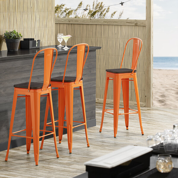 Lancaster Table & Seating Alloy Series Orange Metal Indoor Industrial Cafe Bar Height Stool with Vertical Slat Back and Black Wood Seat Main Image 4
