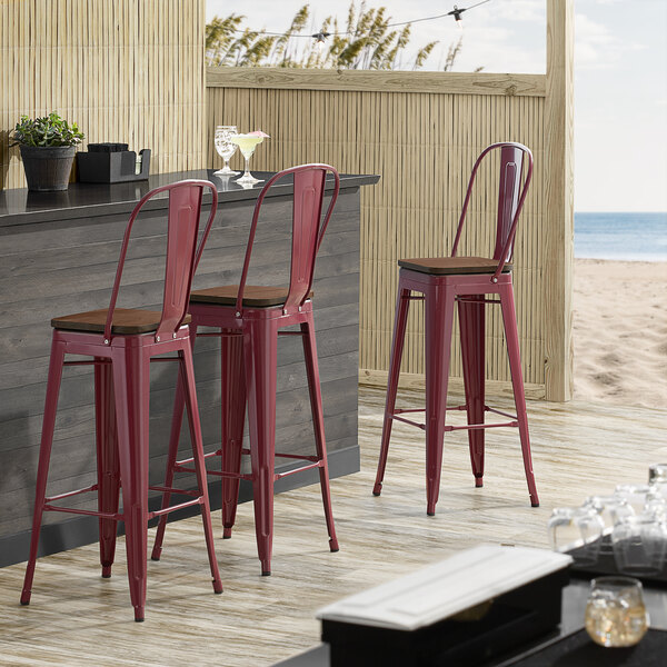 Lancaster Table & Seating Alloy Series Sangria Metal Indoor Industrial Cafe Bar Height Stool with Vertical Slat Back and Walnut Wood Seat Main Image 4
