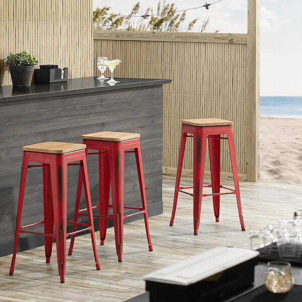 Lancaster Table & Seating Alloy Series Distressed Red Metal Indoor Industrial Cafe Bar Height Stool with Natural Wood Seat Main Image 3